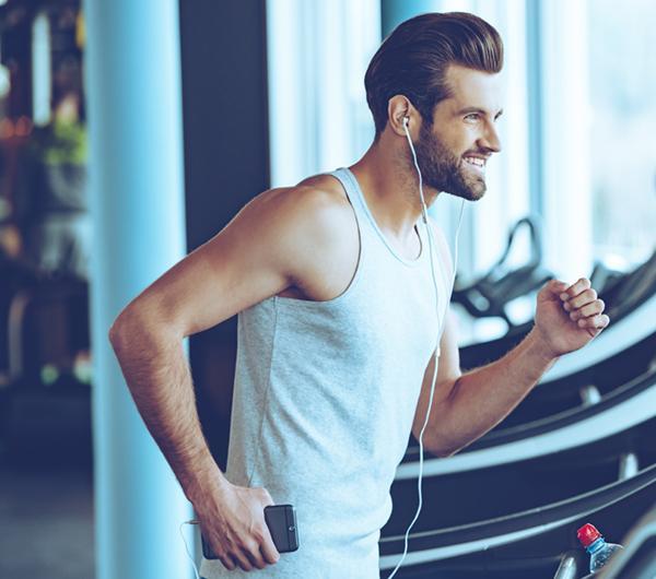 Happy man running on Walkslim treadmill